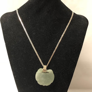 Sterling Silver and Carved Stone Pendant Necklace