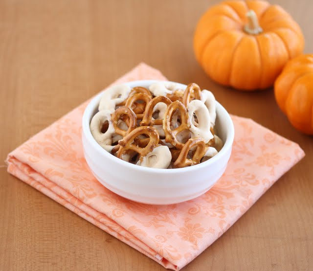 photo of a bowl of Pumpkin Spice Chocolate Covered Pretzels