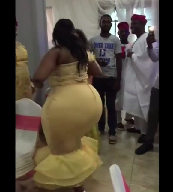 Extremely endowed nigerian lady causes stirs with her backside at a wedding reception.