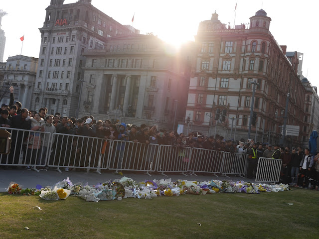 flowers left to remember the people killed and injured by the New Year's Eve stampede in Shanghai