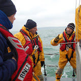 Dr John debriefing the crews' casualty care. The casualty survived - we think! Photo: RNLI Poole/Dave Riley