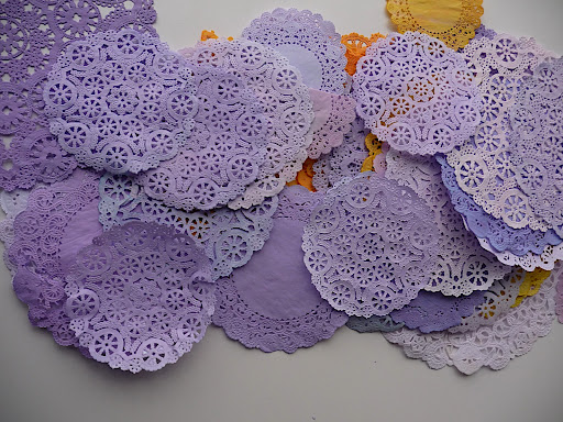 Dyeing these doilies was so fun.  I just started out with a bit of food coloring in the bath, then gradually added the rest of the bottle.  This made for a nice range from subtle to saturated.