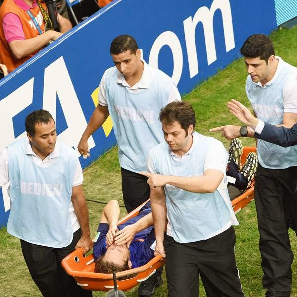 Netherlands' defender Daley Blind is carried off the pitch in a stretcher during the third place play-off football match between Brazil and Netherlands during the 2014 FIFA World Cup at the National Stadium in Brasilia on July 12, 2014.