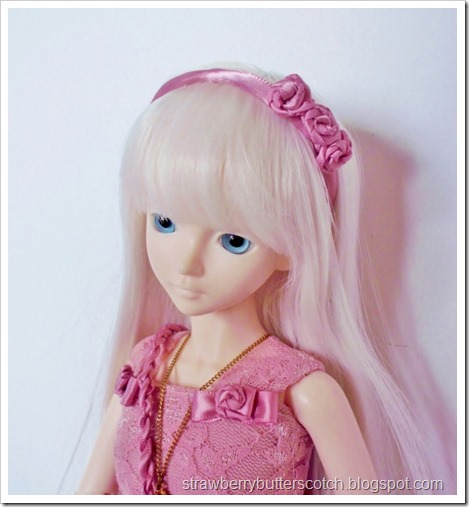 Cute pink rose head band for a doll.