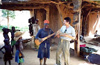 Trying to play each others instruments.... that's a monochord in my hands. Mali, West Africa.