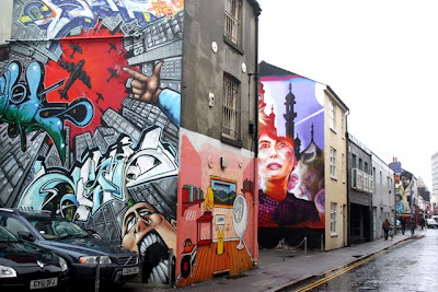 Graffiti on the sides of buildings in the North Laine area of Brighton England