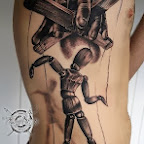 puppet tattooed man in the ribs