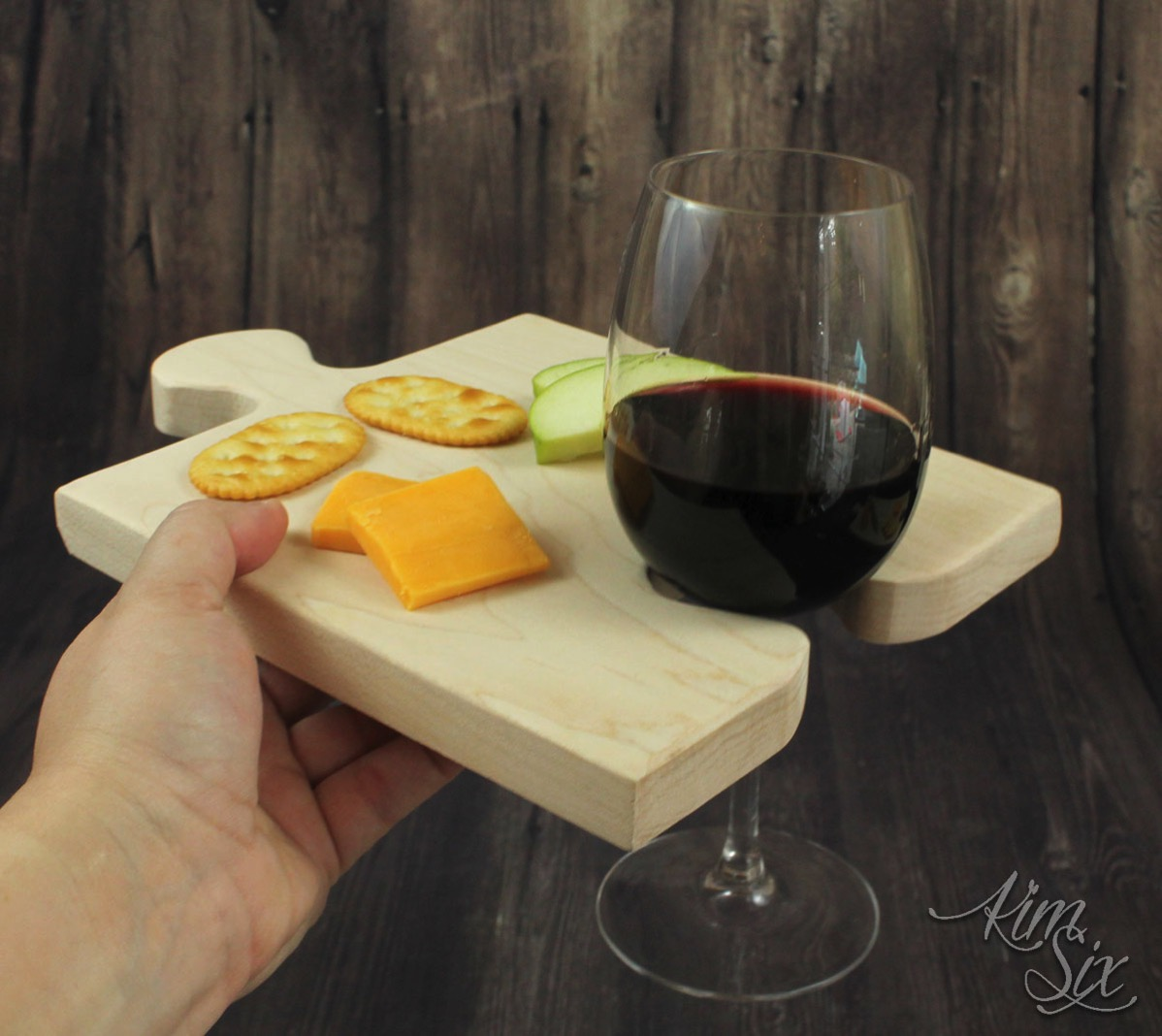 Puzzle cutting board with wine holder