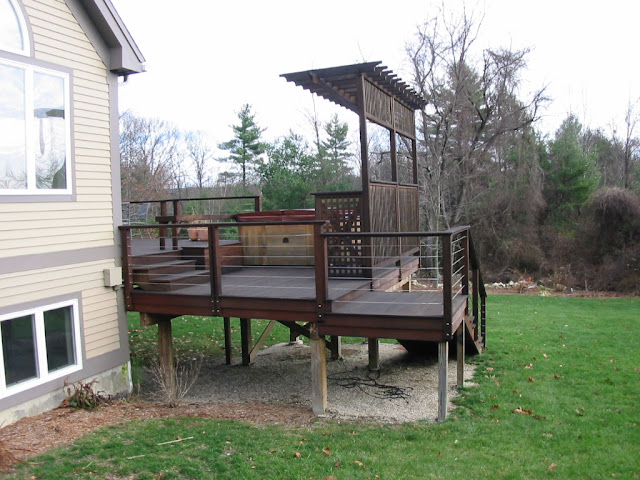 Multi-level deck provides place for hot tub and shade