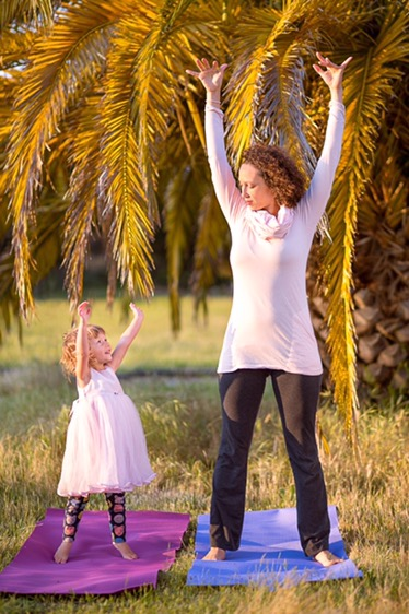 Mom and daughter reaching for the sky
