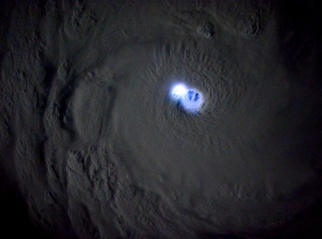 Tropical Cyclone Bansi seen from the International Space Station, when lightning was lighting up the eye. The date of the photo was not given, but presumably is 13 January 2015, when Bansi was near peak intensity as a Category 5 storm with 160 mph winds, according to the Joint Typhoon Warning Center. Photo: Sam Cristoforetti / NASA