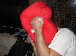 Jeremy hides his head in the red sleeping bag of drunkness