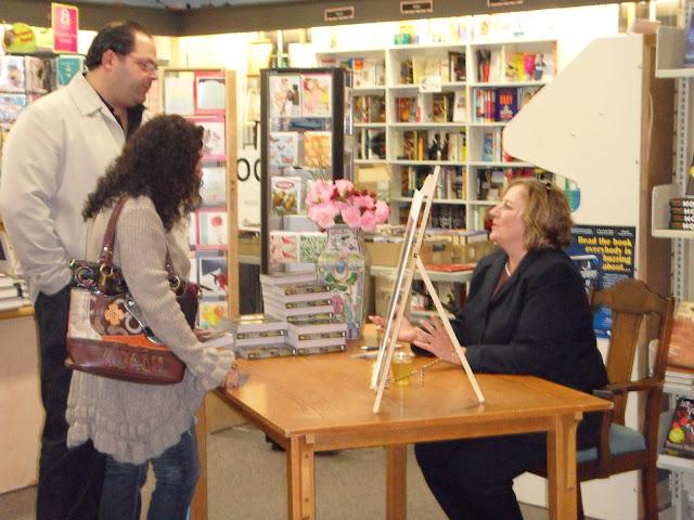 Linda signing books