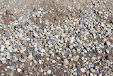 Concrete Mix - Made up of a sand and gravel mix. This is not the actual concrete mix that is bought it bags, rather it is used to add to bags of concrete.