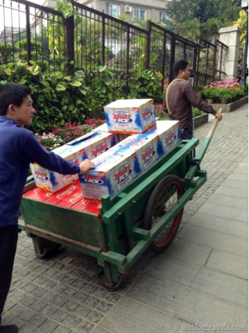 Chinese men pulling bud ice beer cart, gulangyu island