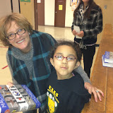 Kim Murphy provides a dictionary to a happy third grader at Kawana Springs Charter Elementary School