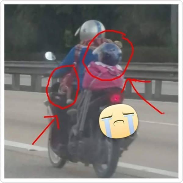 wanita naik motor bersama anak dari penang ke kajang.jpg