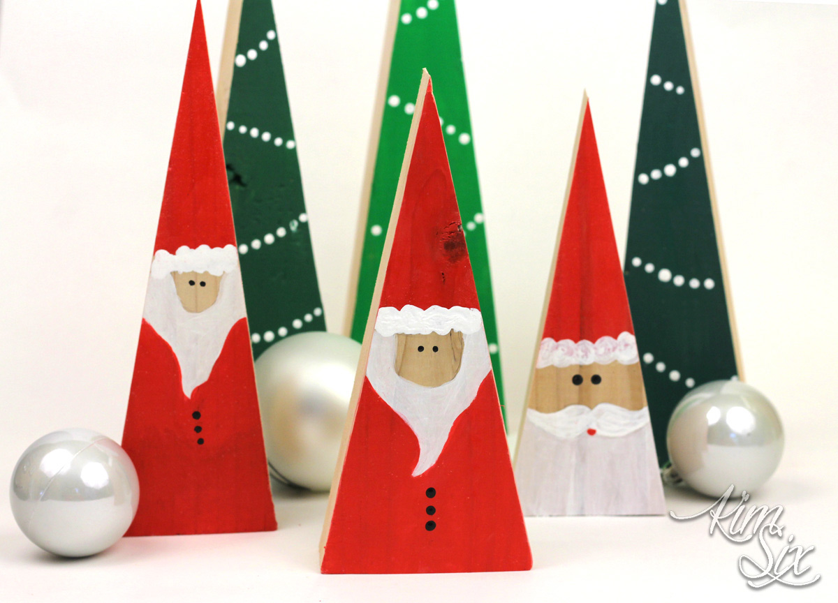 Wooden christmas block santas and trees made from scrap 2x4s.  The painting is simple enough that anyone can do it!