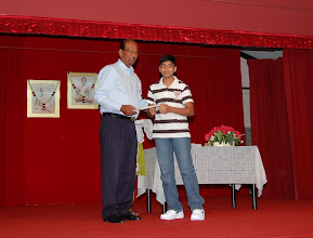 Photo: Vikaesh Moorthy receiving the Excellence Award. He did well in PSLE.