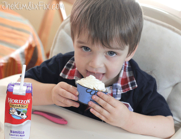 Enjoying a cupcake with milk