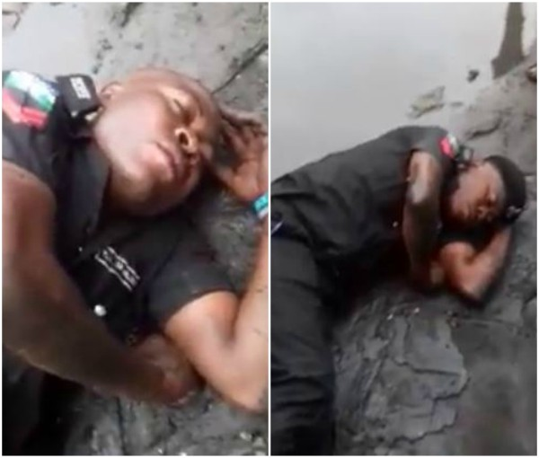 See Photos Of Drunk Nigerian Police Officer Sleeping In Mud Goes Viral