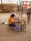 A weaver busy spinning cotton