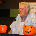 Professor at podium with pumpkins.jpg