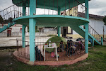 The locals kindly let us pitch our casita under this gazebo to escape the massive downpour. We even had a nice little mesita for a romantic dinner for two.