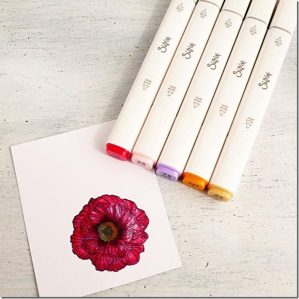 Card con fiore fustellato e colorato con i pennarelli