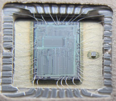 The die of the 8087 FPU chip, showing the bond wires from the die to the package.
