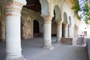 Fading frescos on the pillars on Sikh architecture building