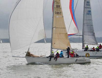 J/92s sailing fast under spinnaker at Warsash Spring Series