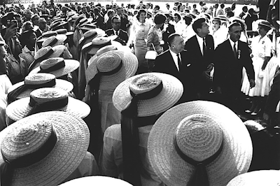 photo of Senator John F Kennedy and his sisters walking with Governor Michael V Di Salle and Governor Abraham A Ribicoff and women in hats,  Los Angeles, CA, 1960