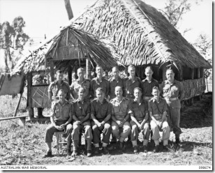 098674 AWM  TOROKINA, BOUGAINVILLE. 1945-11-09. A GROUP OF ANGLICAN CHAPLAINS OUTSIDE THE PATTISON CHAPEL, HEADQUARTERS 3 DIVISION