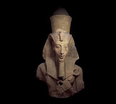 Colossal Statue of Amenhotep IV / Akhenaten  - Numerous colossal sandstone images of Amenhotep IV enhanced the colonnade of the king's temple to the Aten at East Karnak. The double crown, atop the nemes-headdress, alludes to the living king as representative of the sun god.