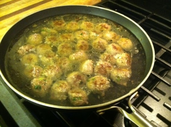 Lower  heat to as low as it can go... add your stock (chicken...