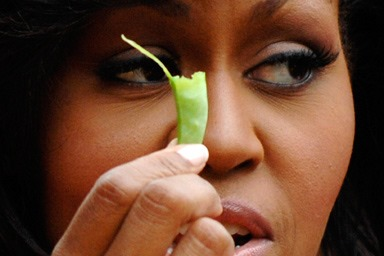 [u_s_first_lady_michelle_obama_holds_a_bean_harvested_from_vegetables_grown_in_her_garden_at_the_white_house_in_washington_june_16_2009%5B3%5D]