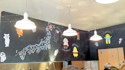 Nodoguro at their old space they rented next to Pastaworks before they moved to the Genoa space in 2016, here decorated for Yurukyara Grand Prix, a Nodoguro Mascot Dinner