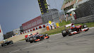 Alonso and Button driving on the main straight