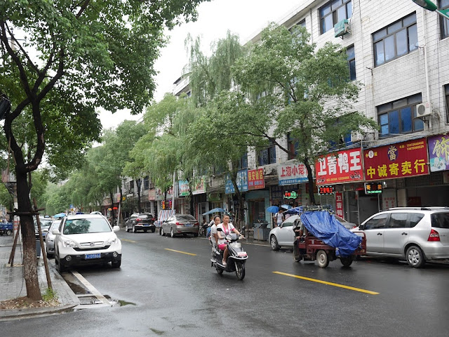two women riding a motorbike in Changde