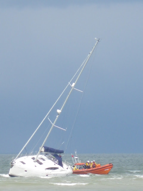 Poole ILB crew setting the anchor on a yacht aground on Hook Sands - 27 April 2013 Photo: RNLI/Anne Millman