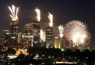 Photo: Fireworks explode on the rooftops of buildings in the city during a show prior to the new year celebrations in Sydney December 31, 2012. More than 1.5 million people were expected to line the foreshores of the harbour to watch the annual fireworks show.        REUTERS/David Gray     (AUSTRALIA - Tags: SOCIETY TPX IMAGES OF THE DAY) AUSTRALIA