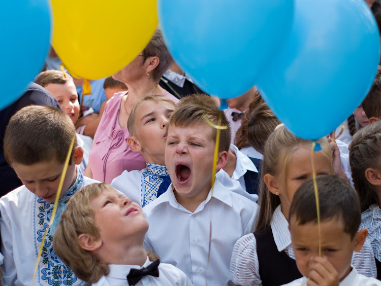First graders attend a ceremony to mark the start of the school year in Kiev, Ukraine.