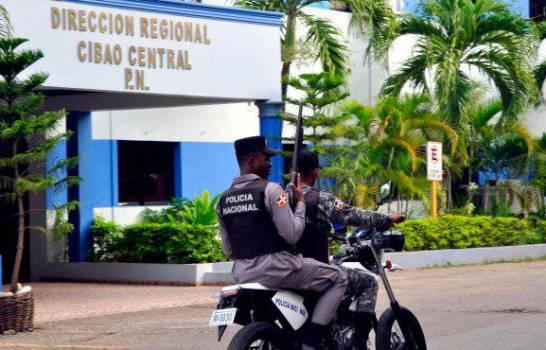 La Policía identifica a uno de varios hombres que mataron comerciante en Santiago