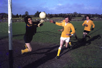 Theo Hackett pulls off a magnificent save as Anthony Morrissey and Noel Grant look on.