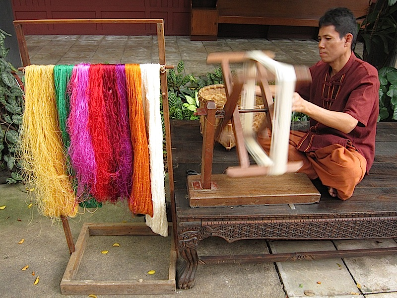 raw silk being spun on a reel at the Jim Thompson House in Bangkok, Thailand