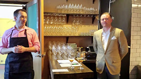 One of the Kargi Gogo owners, Sean in the apron and wine pairings by Jeff Veir in the blazer and pocket handkerchief