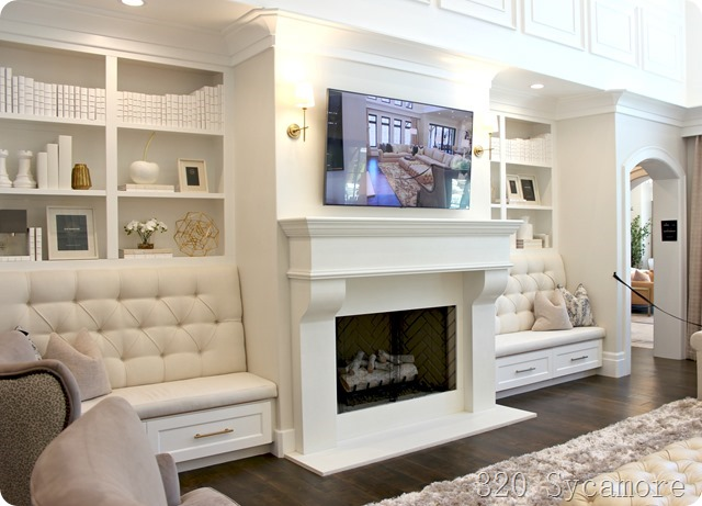 built in banquette seating on either side of fireplace