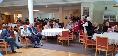 Members and Village residents enjoying the music.