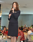 Christine Powell, Belk store manager, speaks from the runway.